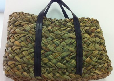 A photograph of a plaited rush bag hand crafted by Christiane Gunzi