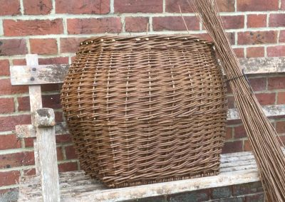 A photograph of a kindling basket hand crafted by Christiane Gunzi