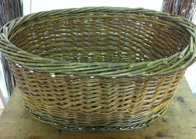 A photograph of a oval laundry basket hand crafted by Christiane Gunzi