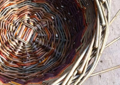 A photograph of a round willow basket hand crafted by Christiane Gunzi
