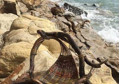A photograph of a piece willow and driftwood 'Wave' hand crafted by Christiane Gunzi