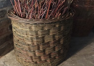 A photograph of a blockweave log basket hand crafted by Christiane Gunzi